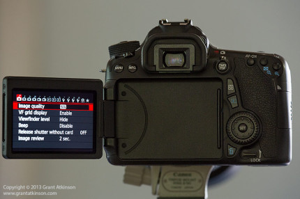 Rear view of EOS 70D with rear touch screen swivelled out.  Click for larger view