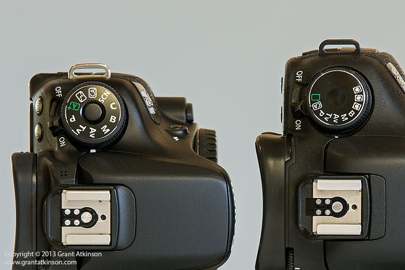 Canon EOS 70D with locking mode dial, and EOS 7D mode dial.